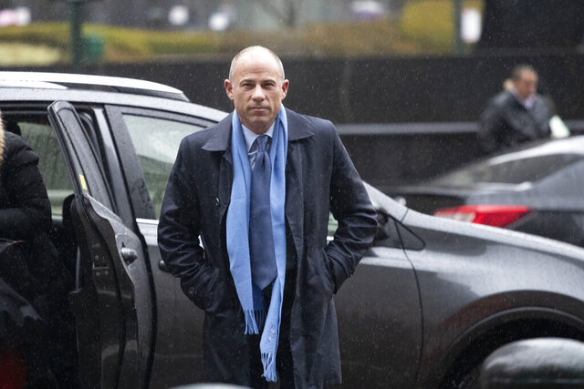 FILE - In this Dec. 17, 2019, file photo, California attorney Michael Avenatti arrives at federal court to enter a plea to an indictment charging him with trying to extort up to $25 million from Nike in New York. A judge has allowed Avenatti to be temporarily freed from a federal jail in New York City and to ride out the coronavirus scare at a friend's house in Los Angeles. On Friday, April 10, 2020, U.S. District Judge James Selna said Avenatti may stay at the home of Jay Mannheimer, near Venice Beach, during the 90-day release period but he first must get tested for COVID-19 and be quarantined for 14 days at a Federal Bureau of Prisons facility. (AP Photo/Mark Lennihan, File)