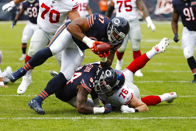 Chicago Bears defensive tackle Nick Williams (97) recovers a fumble by New York Giants quarterback Daniel Jones (8) during the second half of an NFL football game in Chicago, Sunday, Nov. 24, 2019. (AP Photo/Charles Rex Arbogast)