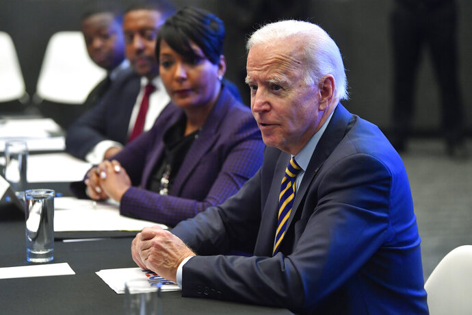 Former Vice President and 2020 Democratic presidential candidate Joe Biden visits with an assembly of Southern black mayors Thursday, Nov. 21, 2019 in Atlanta. (AP Photo/John Amis)