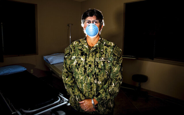 Dr. Sara Hartsaw stands in a procedure room at High Plains Surgical Associates in Gillette, Wyoming, on July 16, 2020. The U.S. Navy Reserve mobilized Hartsaw to New York City in April where she worked in the temporary field hospital built inside of the Javits Convention Center. (Mike Moore/Gillette News Record via AP)
