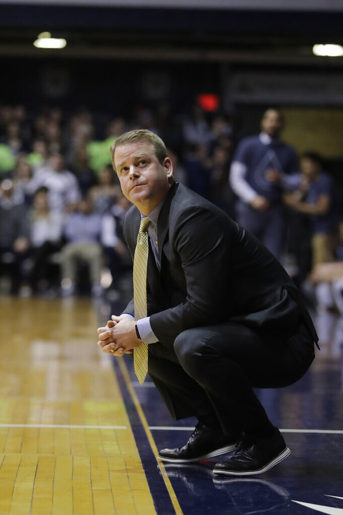 Marquette head coach Steve Wojciechowski looks up at a replay during the first half of an NCAA college basketball game against Butler, Wednesday, Jan. 30, 2019, in Indianapolis. (AP Photo/Darron Cummings)