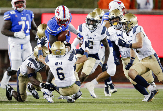 Navy defensive back Mitchell West (6) and linebacker Terrell Adams (41) tackle SMU running back Ulysses Bentley IV (26) during the second half of an NCAA college football game, Saturday, Oct. 31, 2020, in Dallas. (AP Photo/Brandon Wade)