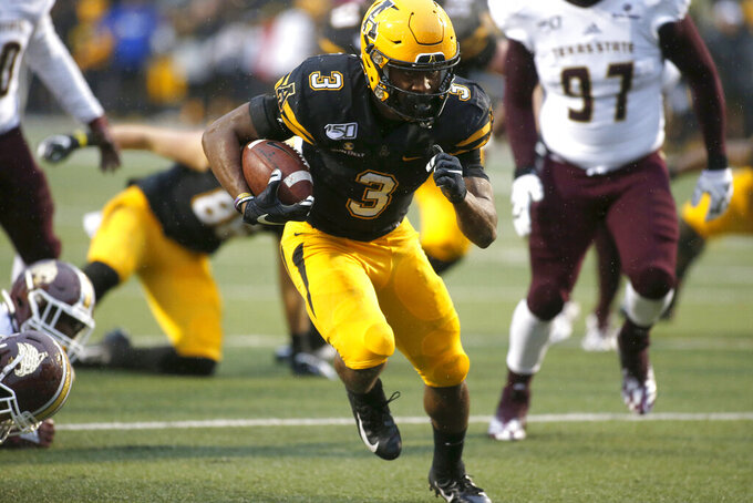 Appalachian State running back Darrynton Evans (3) runs for a touchdown during the second half of an NCAA college football game against Texas State Saturday, Nov. 23, 2019, in Boone, N.C. (AP Photo/Brian Blanco)
