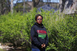 Cicely Fleming, alderwoman of Evanston's 9th Ward, poses for a portrait at her home in Evanston, Ill., Thursday, April 15, 2021. Acknowledging past racist policies, Evanston is giving eligible Black residents $25,000-housing grants for down payments, repairs or existing mortgages this year. Fleming, who voted against the grants, said she supports reparations but Evanston's effort isn't that. Instead of giving money to banks, direct cash payments would give Black people power in deciding how they need repair, she said. (AP Photo/Shafkat Anowar)