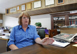 In this Aug. 5, 2019, photo, Susan Reeves sits in her office at the Mount Vernon Optic-Herald as she responds to questions during an interview in Mount Vernon, Texas. Reeves is the publisher of the community newspaper that has been published since 1874 and owned by her family since 1952. Reeves said she was immediately supportive of the school board's decision to hire Art Briles as the high school football coach and believes that is the case for most of the community. (AP Photo/Tony Gutierrez)