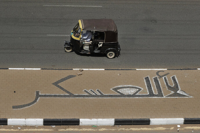 Arabic writing on a roadside street painted by Sudanese opposition reads: