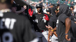 Chicago White Sox's Eloy Jimenez (74) celebrates his two-run home run against the Detroit Tigers in the seventh inning of a baseball game in Detroit, Monday, Sept. 27, 2021. (AP Photo/Paul Sancya)