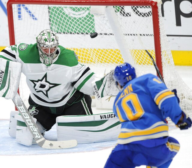 St. Louis Blues' Brayden Schenn (10) scores against Dallas Stars' Anton Khudobin (35), of Russia, during the second period of an NHL hockey game, Saturday, Feb. 29, 2020, in St. Louis. (AP Photo/Bill Boyce)
