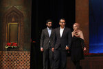 UCLA professor Ali Khademhosseini, center, arrives to receive the Mustafa scientific prize at a ceremony in Tehran, Iran, Monday, Nov. 11, 2019. Iran on Monday awarded a top prize in the study of science and technology to two U.S.-educated scientists -- Khademhosseini, for his work on the application of nanostructures in the treatment of disease and Umran Inan, a Turkish professor of electrical engineering at Stanford University. (AP Photo/Vahid Salemi)
