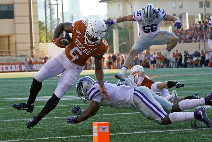Texas' Devin Duvernay (6) is knocked out of bounds by Kansas State's Da'Quan Patton during the second half of an NCAA college football game in Austin, Texas, Saturday, Nov. 9, 2019. (AP Photo/Chuck Burton)