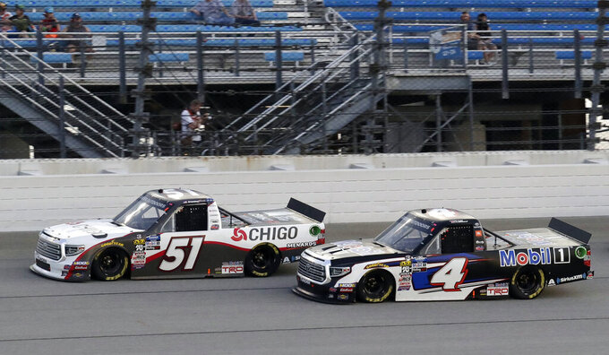 Brandon Jones, left, drives past Todd Gilliland during the NASCAR Truck Series auto race at Chicagoland Speedway in Joliet, Ill., Friday, June 28, 2019. (AP Photo/Nam Y. Huh)