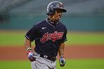 FILE - In this July 10, 2020, file photo, Cleveland Indians' Francisco Lindor runs the bases after hitting a home run during a simulated game at Progressive Field in Cleveland. The Indians are changing their name after 105 years, a person familiar with the decision told The Associated Press on Sunday, Dec. 13, 2020. After months of internal discussion prompted by public pressure and a national movement to remove racist names and symbols, the team is moving away from the name it has been called since 1915, said the person who spoke on condition of anonymity because the team has not revealed its plans. (AP Photo/David Dermer, File)