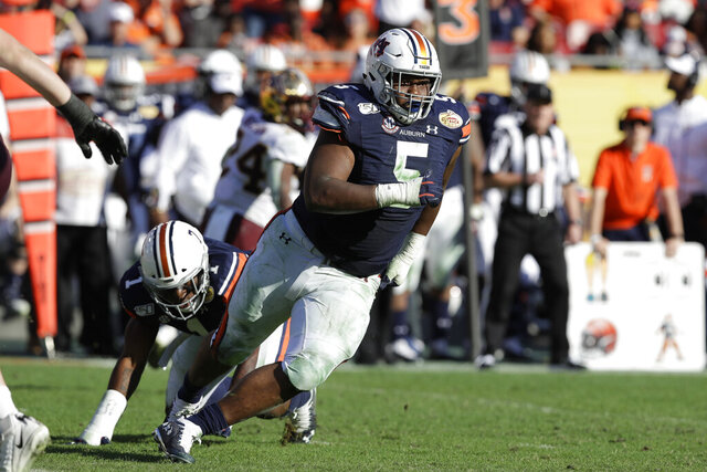 FILE - In this Jan. 1, 2020, file photo, Auburn defensive tackle Derrick Brown (5) runs during the second half of the Outback Bowl NCAA college football game against Minnesota in Tampa, Fla. The Carolina Panthers selected Brown with the seventh pick in the first round of the NFL draft. (AP Photo/Chris O'Meara, File)