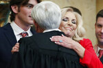 Attorney General Lynn Fitch hugs her friend, Mississippi Supreme Court Chief Justice Michael Randolph, after swearing Fitch into office, in House chambers at the Mississippi Capitol in Jackson, Miss., Thursday, Jan. 9, 2020. (AP Photo/Rogelio V. Solis)