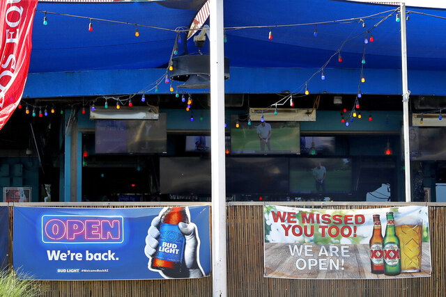 A sports bar is empty before it closed early Monday, June 29, 2020, in Phoenix. Arizona Gov. Doug Ducey has shut down bars, movie theaters, gyms and water parks amid a dramatic resurgence of coronavirus cases. (AP Photo/Matt York)
