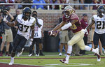 Florida State's TreShaun Harrison runs past Wake Forest's Nasir Greer to score a touchdown in the fourth quarter of an NCAA college football game, Saturday, Oct. 20, 2018 in Tallahassee, Fla. Florida State won 38-17. (AP Photo/Steve Cannon)