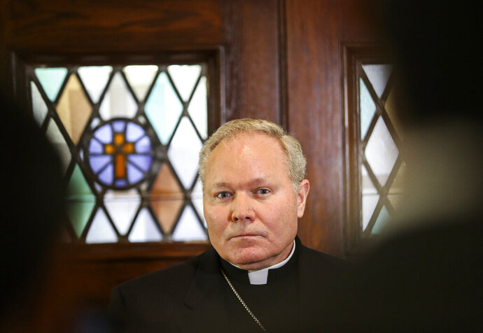Dallas Bishop Edward J. Burns speaks to members of the media following a police raid on several Diocese of Dallas offices, Wednesday, May 15, 2019, at Holy Trinity Catholic Church in Dallas. A police commander says a search at the Catholic Diocese of Dallas began when an investigation into child sexual abuse allegations against a former priest uncovered claims against others. (Ryan Michalesko/The Dallas Morning News via AP)