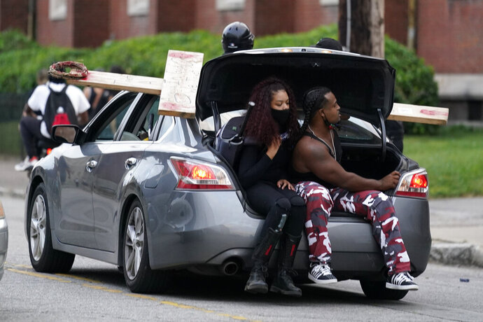 People participate in a protest march, Friday, Sept. 25, 2020, in Louisville. Breonna Taylor's family demanded Friday that Kentucky authorities release all body camera footage, police files and the transcripts of the grand jury hearings that led to no charges against police officers who killed the Black woman during a March drug raid at her apartment. (AP Photo/Darron Cummings)