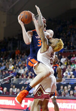Boston College guard Ky Bowman (0) takes the charge as Virginia forward Jay Huff (30) drives into him during the first half of an NCAA basketball game Wednesday, Jan. 9, 2019, in Boston. (AP Photo/Mary Schwalm)
