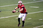 Wisconsin quarterback Graham Mertz (5) passes against Minnesota during the first half of an NCAA college football game Saturday, Dec. 19, 2020, in Madison, Wis. (AP Photo/Andy Manis)