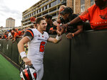 Oregon State quarterback Jake Luton high fives fans after the team's overtime win against Colorado in an NCAA football game, Saturday, Oct. 27, 2018, in Boulder, Colo. (AP Photo/Jack Dempsey)