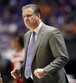 Kentucky head coach John Calipari reacts to a play in the first half of an NCAA college basketball game against Alabama at the Southeastern Conference tournament Friday, March 15, 2019, in Nashville, Tenn. (AP Photo/Mark Humphrey)