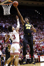 Iowa forward Tyler Cook (25) shoots over Indiana forward Justin Smith (3) during the first half of an NCAA college basketball game in Bloomington, Ind., Thursday, Feb. 7, 2019. (AP Photo/AJ Mast)