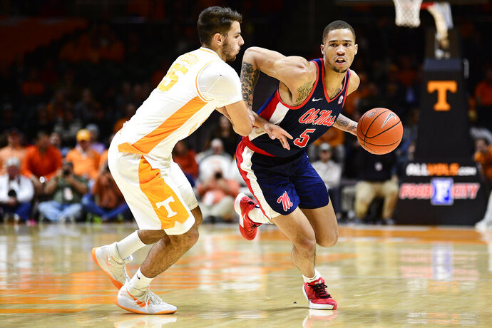 Mississippi forward KJ Buffen (5) is defended against by Tennessee guard Santiago Vescovi (25) during an NCAA college basketball game, Tuesday, Jan. 21, 2020 in Knoxville, Tenn. (Calvin Mattheis/Knoxville News Sentinel via AP)