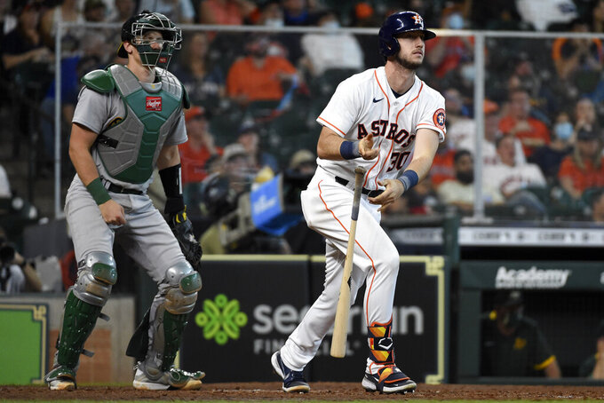 Houston Astros' Kyle Tucker, right, watches his solo home run during the seventh inning of a baseball game against the Oakland Athletics, Saturday, April 10, 2021, in Houston. (AP Photo/Eric Christian Smith)