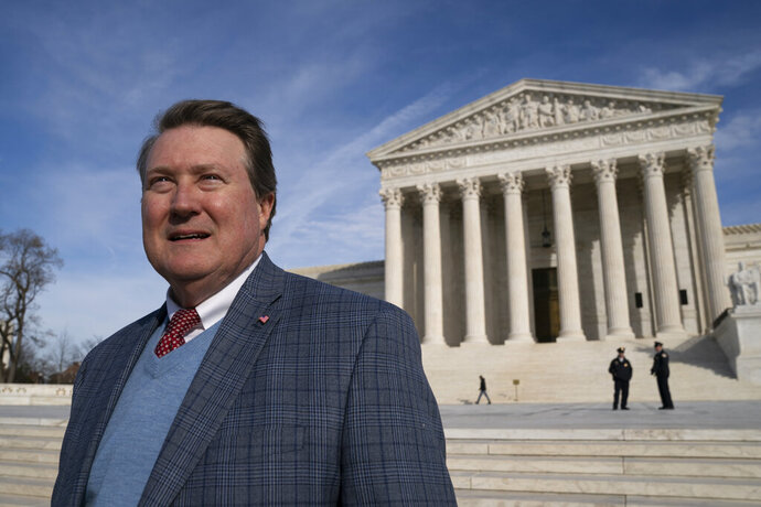 Mitch Hungerpiller of Birmingham, Ala., who invented a computerized system to automate the processing of returned mail, visits the Supreme Court in Washington, on Feb. 14, 2019, where his decade-long fight with the post office over patent infringement will be heard. (AP Photo/J. Scott Applewhite)