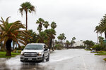 A truck drives down a flooded street in Key Allegro area of Rockport, Texas, as Tropical Storm Beta approaches on Monday, Sept. 21, 2020/  (Courtney Sacco/Corpus Christi Caller-Times via AP)