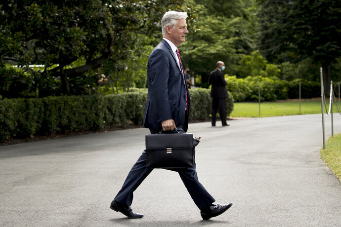 FILE - In this July 10, 2020, file photo White House national security adviser Robert O'Brien walks South Lawn of the White House in Washington. O'Brien who tested positive for the coronavirus, returned to work on Tuesday, Aug. 4, after recovering from a mild case of COVID-19, the White House said. (AP Photo/Andrew Harnik, File)