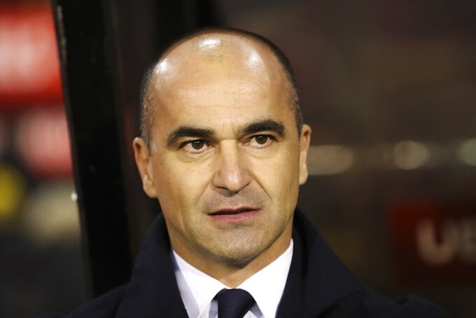 FILE - In this Tuesday, Nov. 19, 2019 file photo, Belgium coach Roberto Martinez stands prior to a soccer match between Belgium and Cyprus at the King Baudouin stadium in Brussels. Jeremy Doku and Leandro Trossard were called up Monday, May 17, 2021 for the Belgium squad alongside the usual stalwarts for the European Championship. Belgium will play in Group B, opening against Russia on June 12. The top-ranked Belgians will then face Denmark and Finland. (AP Photo/Francisco Seco, File)
