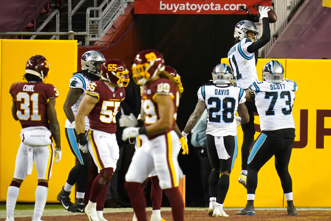 Carolina Panthers wide receiver Robby Anderson (11) celebrating his touchdown against the Washington Football Team with teammates during the first half of an NFL football game, Sunday, Dec. 27, 2020, in Landover, Md. (AP Photo/Carolyn Kaster)