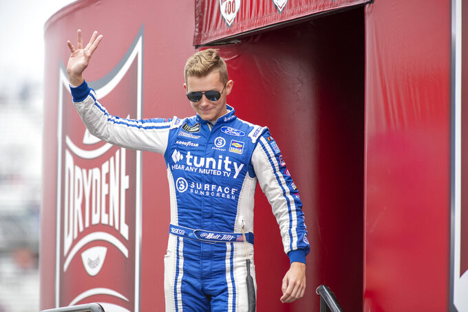 Matt Tifft (36) walks on to the stage during driver introductions at the Drydene 400 - Monster Energy NASCAR Cup Series playoff auto race, Sunday, Oct. 6, 2019, at Dover International Speedway in Dover, Del. (AP Photo/Jason Minto)