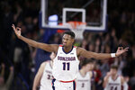 Gonzaga guard Joel Ayayi (11) gestures after scoring a basket during the second half of the team's NCAA college basketball game against Saint Mary's in Spokane, Wash., Saturday, Feb. 29, 2020. Gonzaga won 86-76. (AP Photo/Young Kwak)