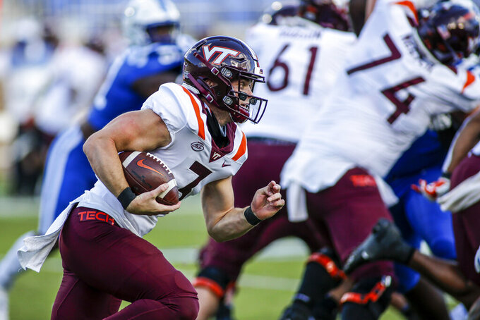 Virginia Tech quarterback Braxton Burmeister (3) carries the ball against Duke during the first half of an NCAA college football game, Saturday, Oct. 3, 2020, in Durham, N.C.  (Nell Redmond/Pool Photo via AP)