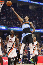 Cleveland Cavaliers' Alfonzo McKinnie shoots against the Los Angeles Clippers in the first half of an NBA basketball game, Sunday, Feb. 9, 2020, in Cleveland. (AP Photo/Tony Dejak)