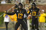 Missouri wide receiver Johnathon Johnson, left, celebrates a his touchdown in front of teammate Kam Scott, right, during the second half of an NCAA college football game against Wyoming, Saturday, Sept. 8, 2018, in Columbia, Mo. (AP Photo/L.G. Patterson)