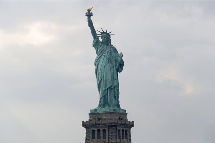 FILE - In this Aug. 14, 2019 file photo, The Statue of Liberty is shown in New York. The Department of Homeland Security says New York residents will be cut off from 'trusted traveler' programs because of a state law that prevents immigration officials from accessing motor vehicle records. Acting Deputy DHS Secretary Ken Cuccinelli says tens of thousands of New Yorkers will be inconvenienced by the action.  (AP Photo/Kathy Willens)