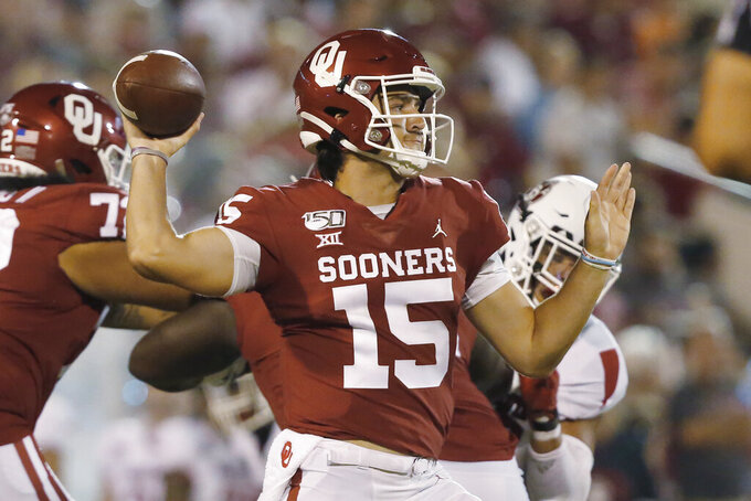 FILE - In this Saturday, Sept. 7, 2019 file photo, Oklahoma quarterback Tanner Mordecai (15) throws in the fourth quarter of an NCAA college football game against South Dakota, in Norman, Okla. Mordecai is competing with Spencer Rattler for the starting spot. (AP Photo/Sue Ogrocki, File)