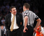 Georgia Tech head coach Josh Pastner speaks with an official in the first half of an NCAA college basketball game against the Virginia Tech Wednesday, Jan. 9, 2019, in Atlanta. (AP Photo/John Bazemore)