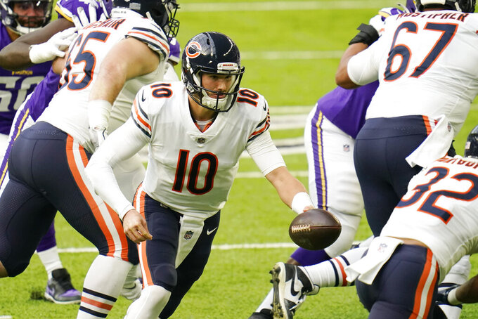 Chicago Bears quarterback Mitchell Trubisky (10) looks to hand the ball off during the first half of an NFL football game against the Minnesota Vikings, Sunday, Dec. 20, 2020, in Minneapolis. (AP Photo/Jim Mone)