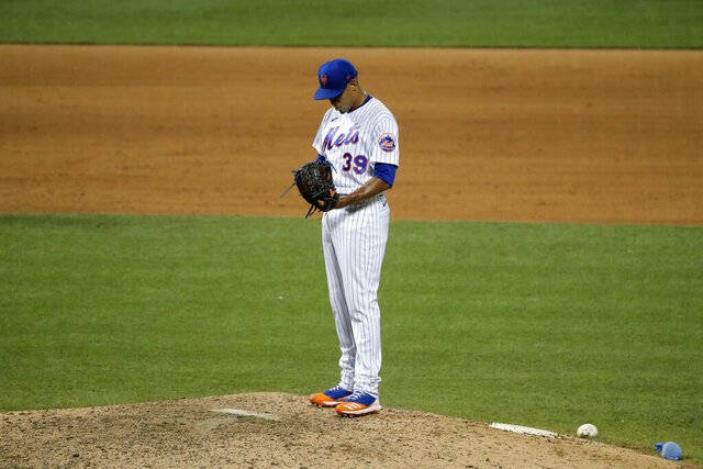 New York Mets relief pitcher Edwin Diaz stands on the mound after hitting Boston Red Sox's Jose Peraza with a pitch which resulted in a run during the ninth inning of the baseball game at Citi Field, Thursday, July 30, 2020, in New York. (AP Photo/Seth Wenig)