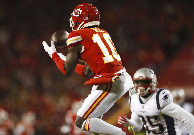 Kansas City Chiefs wide receiver Tyreek Hill (10) makes a catch during the first half of the AFC Championship NFL football game against the New England Patriots, Sunday, Jan. 20, 2019, in Kansas City, Mo. (AP Photo/Jeff Roberson)