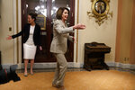 House Speaker Nancy Pelosi of Calif., arrives for a ceremonial swearing in outside the House chamber, Monday June 3, 2019, on Capitol Hill in Washington, just after the House voted to approve a $19 billion disaster aid bill, breaking a conservative blockade and sending the measure to President Trump, who is expected to sign it. (AP Photo/Jacquelyn Martin)