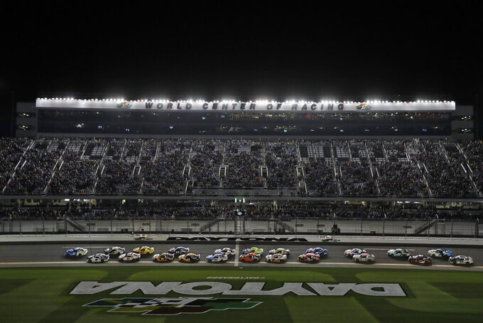Drivers take the green flag to start the first of two NASCAR Daytona 500 qualifying auto races Thursday, Feb. 13, 2020, at Daytona International Speedway in Daytona Beach, Fla. (AP Photo/Chris O'Meara)