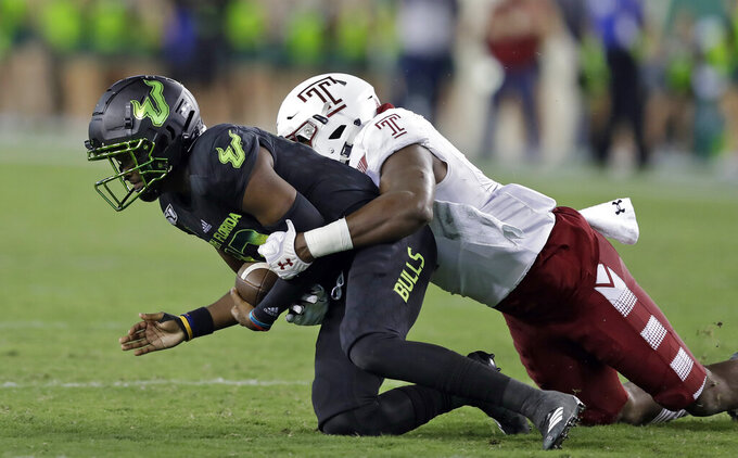 South Florida quarterback Jordan McCloud (12) is sacked by Temple defensive end Arnold Ebiketie (47) during the second half of an NCAA college football game Thursday, Nov. 7, 2019, in Tampa, Fla. (AP Photo/Chris O'Meara)