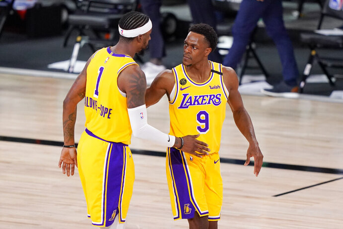 Los Angeles Lakers' Kentavious Caldwell-Pope (1) and Rajon Rondo (9) congratulate one another after beating the Denver Nuggets 114-108 in an NBA conference final playoff basketball game Thursday, Sept. 24, 2020, in Lake Buena Vista, Fla. (AP Photo/Mark J. Terrill)