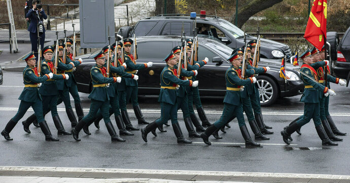 Russian honor guards pass North Korean leader Kim Jong Un's limousine during a wreath-laying ceremony in Vladivostok, Russia, Friday, April 26, 2019. German automaker Daimler, which makes armored limousines used by North Korean leader Kim Jong Un, says it has no idea where he got them and has no business dealings with the North. (AP Photo/Alexander Khitrov)